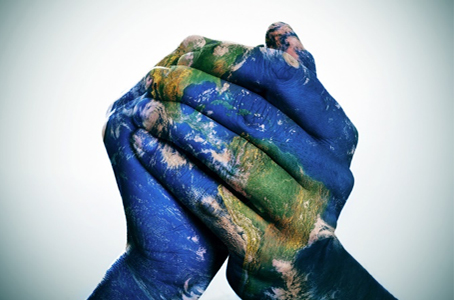 hands painted as the earth clasped together
